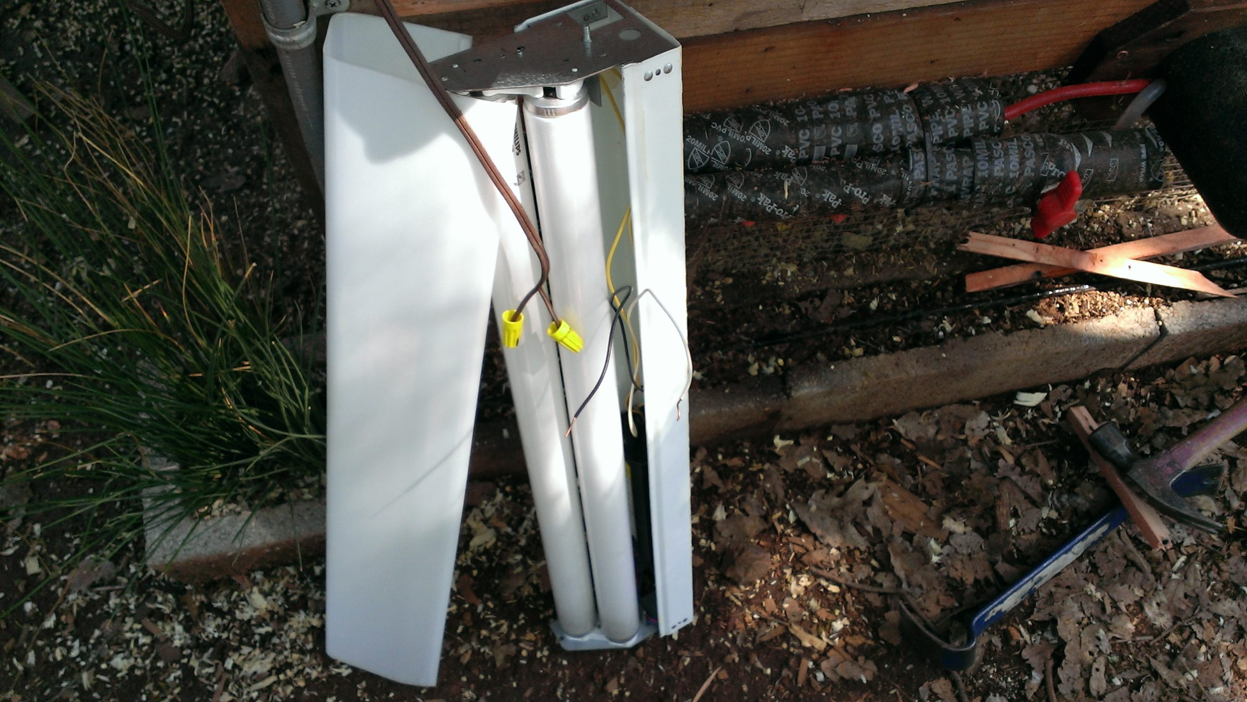 Wiring Chicken Coop Heater (shop light with cover off) - Construction Exterior Pipe Protection (mounted under stairs and above wrapped pipe)