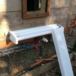 Chicken Coop Heater (shop light with cover off) - Exterior Pipe Protection (mounted under stairs and above wrapped pipe)